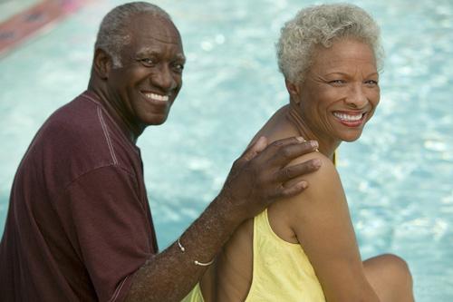 Senior Couple Relaxing Poolside